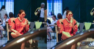 Đáp chuyến bay muộn về Việt Nam, Hoàng Yến trốn một góc vô tư ngồi ăn kem