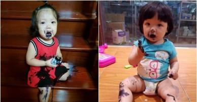 Bé gái 14 tháng tuổi mếu máo, miệng lấm lem vì nghịch lọ mực
