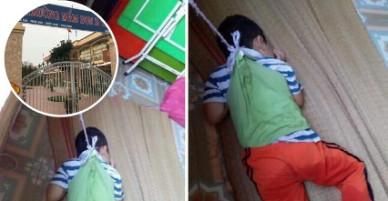Loạt hình ảnh gây phẫn nộ dư luận: bé trai bị cô giáo buộc dây vào người, treo lên cửa sổ trường mần non.
